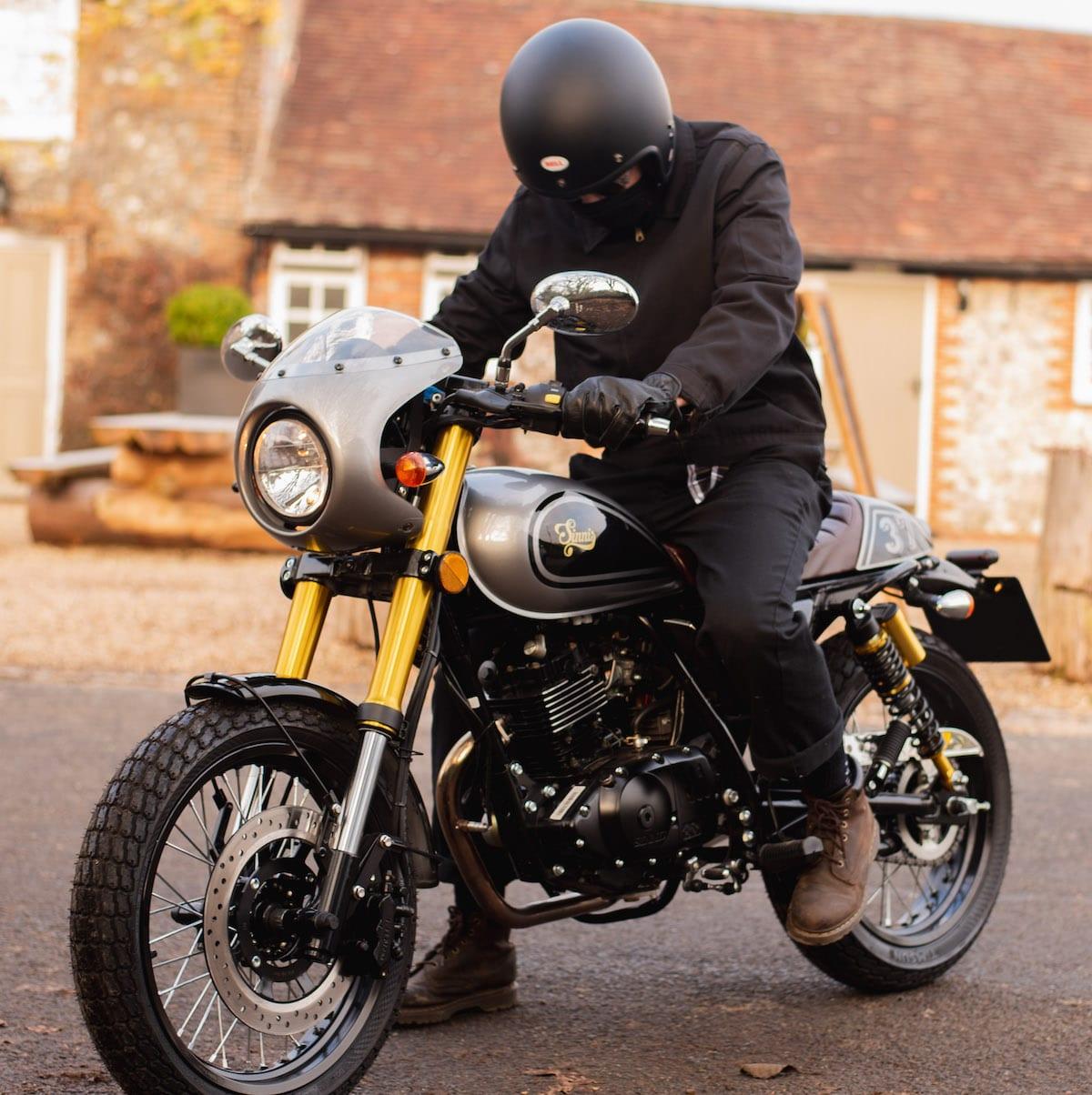 Man riding Sinnis Bomber 125cc